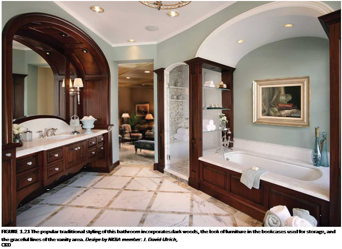 Подпись: FIGURE 1.21 The popular traditional styling of this bathroom incorporates dark woods, the look of furniture in the bookcases used for storage, and the graceful lines of the vanity area. Design by NKBA member: J. David Ulrich, CKD