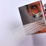 Nozzle for a shower with a mirror