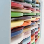 Bright multi-colored dresser on thin legs
